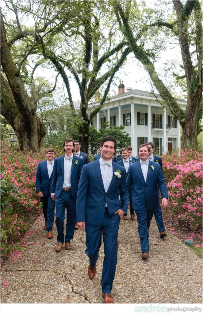 wedding photos groom and groomsmen in blue suits and bowties