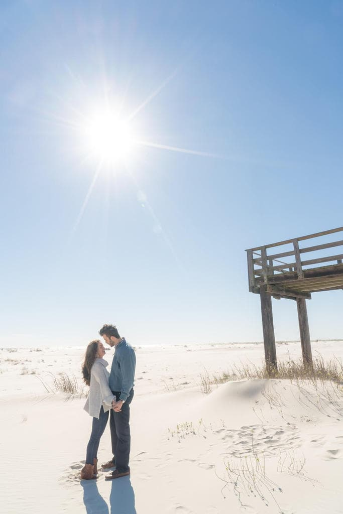 Peyton and Addison beach engagement photos on dauphin island by the pier