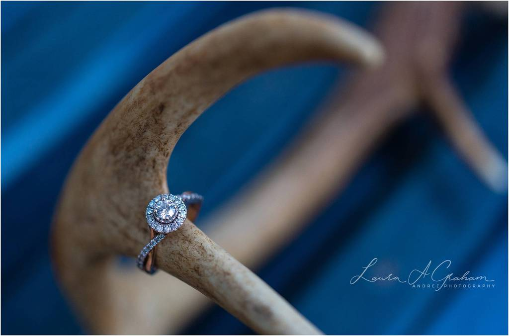 rose gold engagement ring on antlers in blue truckbed